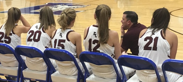 TOP PHOTO: Edward Little High School coach Chris Cifelli watches the action at the 11th annual Auburn-Lewiston Sports Hall of Fame/Gipper's Tip-off Classic held annually the Friday and Saturday after Thanksgiving. The team from Auburn matched up with the Hornets from Leavitt Area High School in Turner, where Cifelli teaches. From left, Madisyn Turcotte, Shelbi Teehan, Audrey Hamel, Jade Perry and Chantel Ouellette. EL came out on top, 54-25. (Elizabeth Galway photo)