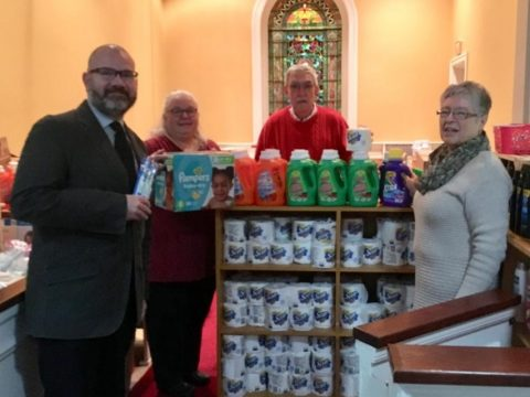 From left, Pastor Mark Wilson, Gail Morris, Carl Daiker and Lora Downing organize items and volunteer in the Essentials Closet at the First Congregational Church, Eustis Parkway, Waterville. (Submitted photo)