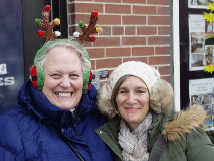 Pam Yenco of Farmington and Bev Yoon of Wilton were just two of hundreds of parade watchers on Chester Greenwood Day to be wearing ear muffs of one style or another.