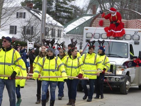 A team of EMTs led by Rod Cohen guide the North Star Ambulance Service Dec. 1 at the Chester Greenwood Parade in Farmington. (Bill Van Tassel photo)